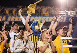 Nov 4, 2017; Morgantown, WV, USA; West Virginia Mountaineers students cheer during the fourth quarter against the Iowa State Cyclones at Milan Puskar Stadium. Mandatory Credit: Ben Queen-USA TODAY Sports