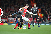 Bayern Munich midfielder Thiago Alcantara (6) battles for possession with Arsenal midfielder Aaron Ramsey (8) during the Champions League round of 16, game 2 match between Arsenal and Bayern Munich at the Emirates Stadium, London, England on 7 March 2017. Photo by Matthew Redman.