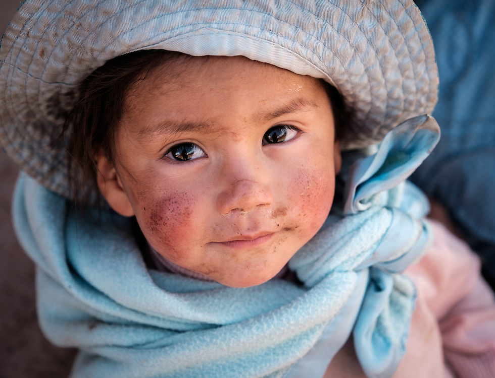MARAS, PERU - CIRCA OCTOBER 2015:  Portrait of local girl in the town of Maras, a small village in the Cusco region known as Sacred Valley