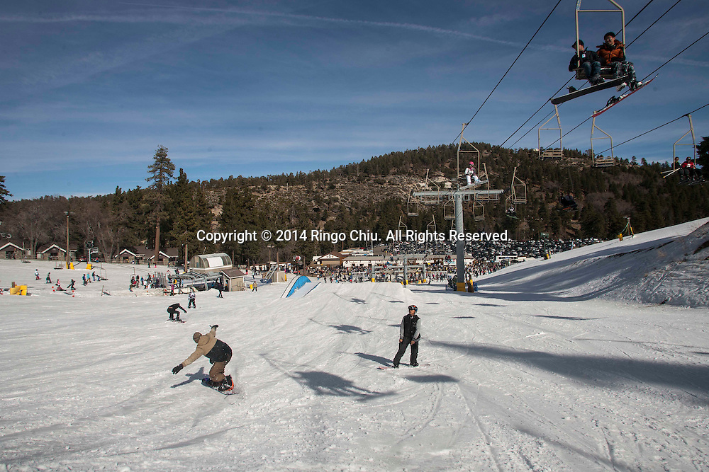 Skiers and Snowboarders have fun at Mountain High resort in Wrightwood , California Friday January 3, 2014. Warm temperatures hit Southern California, which stand in stark contrast to record snowfall in the east. According National Weather Service, a record high temperature of 68 degrees was set at Sandberg, California today. This tied the old record of 68 set in 2012.   (Photo by Ringo Chiu/PHOTOFORMULA.com)