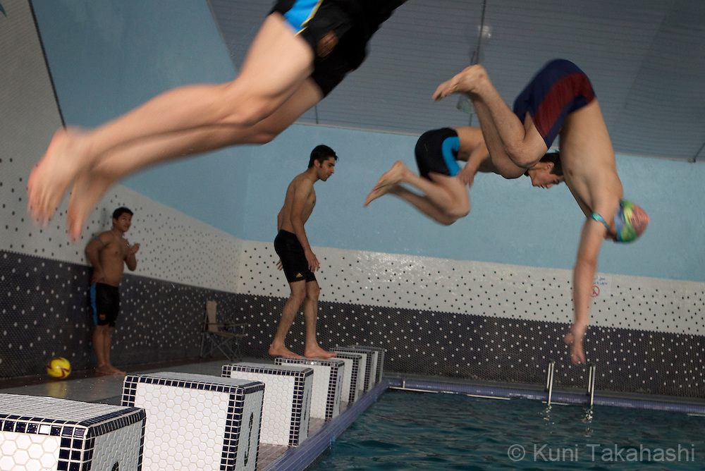 (Kabul, Afghanistan - May 16, 2012).Swimmers dive in at the brand-new indoor swimming pool in Kabul, Afghanistan on May 16, 2012. The largest indoor swimming facility in the country has Jacuzzi, steam bath and a cafeteria as well as swimming training programs. .(Photo by Kuni Takahashi)