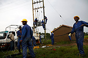 Utility workers from Kenya Power install a transformer to bring electricity to the Mama Rita Rose garden in Kisumu, Kenya, Tuesday, August 7, 2012.  The power was the final step to get the well up and running to bring clean water to the community.  The village had to battle the power company bureaucracy for months to get them to install the transformer, then on their first attempt to ship the transformer it was stolen en route.  The well sat without electricity for months.  Angry community members kept pressuring the power company, but to no avail.  When Mama Hope was in town, they went along to a meeting as support.  The power company came out and had the well up and running in two days.