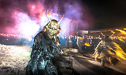 THEMENBILD - KRAMPUSLAUF, am Freitag, 30. November 2012, in Kaprun im Pinzgau. Der Krampus ist im ostalpenlaendischen Adventsbrauchtum eine Schreckgestalt, meist in Begleitung des Heiligen Nikolaus. Hier im Bild Krampuse waehrend ihres Auftrittes. // THEME PICTURE - Krampus, the mythical creature that, according to legend, accompanies Saint Nicholas during the festive season.  Instead of giving gifts to good children, he punishes the bad ones. In the picture is a Krampus. Image taken on 30.11.2012, Kaprun, Austria. EXPA Pictures © 2012, PhotoCredit: EXPA/ Juergen Feichter