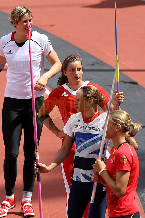 Jessica Ennis of Great Britain (2nd right) waits to compete in the javelin event held as part of the Women's Heptathlon on day 2 of the track and field meet at the Olympic Stadium in Olympic Park in London as part of the London 2012 Olympics on the 3rd August 2012..Photo by Ron Gaunt/SPORTZPICS