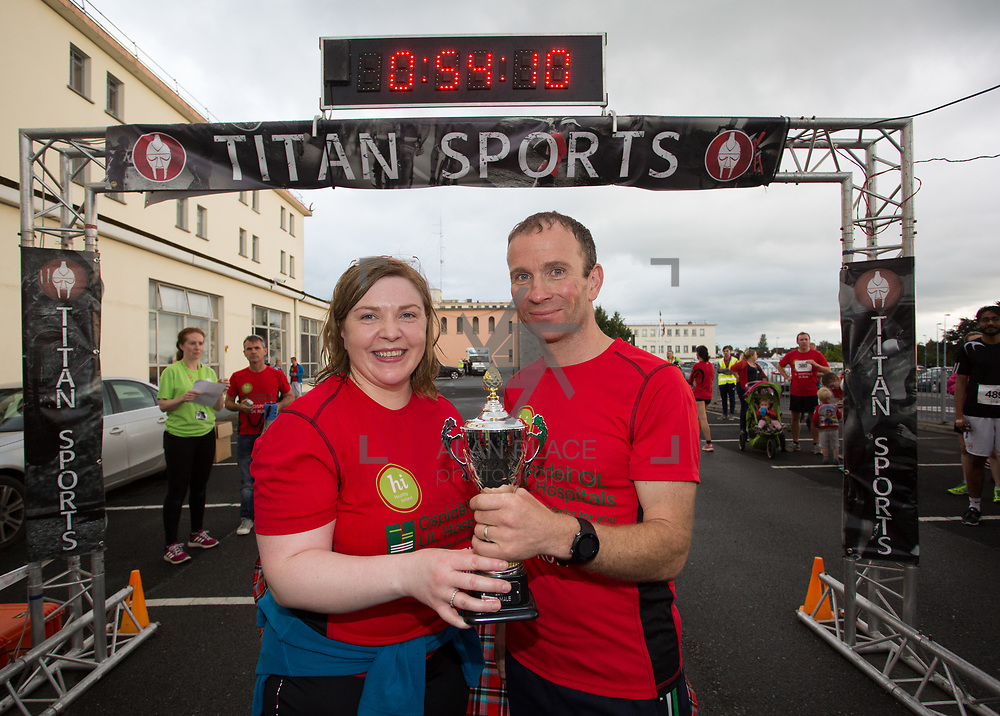 25.08. 2017.                                                      <br /> Almost 200 UL Hospitals Group staff, past and present, and members of the public completed the annual 5k Charity Run/Walk on Friday August 25th in Limerick.<br /> <br /> Josephine Hynes, UHL Group HR Director presents the 3rd place trophy to Peter Madden, Templemore A.C..<br /> <br /> <br /> Everybody who participated also raised funds for Friends of Ghana, an NGO formed last year by UL Hospitals Group and its academic partner the University of Limerick to deliver medical training programmes in the remote Upper West Region of Ghana. Picture: Alan Place