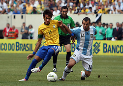 JUNE 09 2012:   Javier Mascherano (14) of Argentina moves in to tackle Neymar (11) of Brazil during an international friendly match at Metlife Stadium in East Rutherford,New Jersey. Argentina won 4-3.