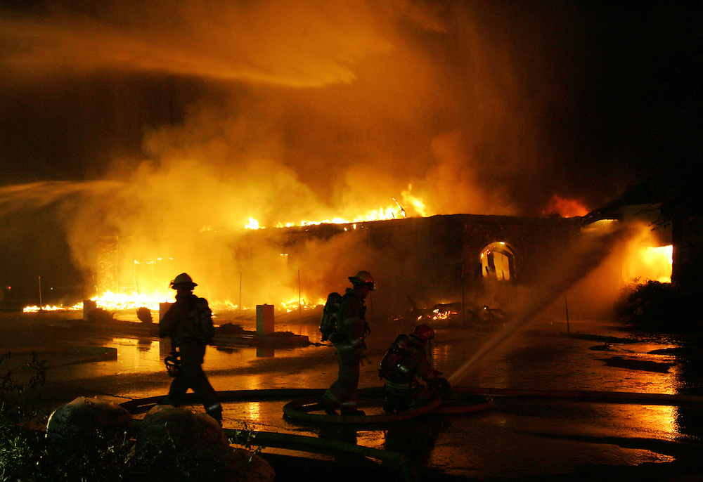 McAllen, TX - 28 Nov 2007 -.McAllen firefighters work to control a 2-alarm fire at the empty La Mexicana restaurant at 4711 N. 10th St. in McAllen on Wednesday night.  The building, which had been empty for several years, was completely destroyed..Photo by Alex Jones / ajones@themonitor.com.