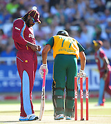 Chris Gayle of the West Indies chats to Reeza Hendricks of South Africa during the 2015 KFC T20 International game between South Africa and the West Indies at Newlands Cricket Ground, Cape Town on 9 January 2015 ©Ryan Wilkisky/BackpagePix