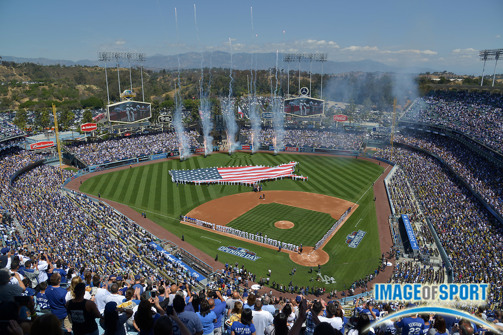 Apr 6, 2015; Los Angeles, CA, USA; General view of a United States flag on the field during the playing of the national anthem before the 2015 MLB opening day game between the San Diego Padres and the Los Angeles Dodgers at Dodger Stadium.