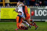 Widnes Vikings stand off Joe Mellor (6) is caught high by Castleford Tigers scrum half Luke Gale (7)  during the Betfred Super League match between Castleford Tigers and Widnes Vikings at the Jungle, Castleford, United Kingdom on 11 February 2018. Picture by Simon Davies.