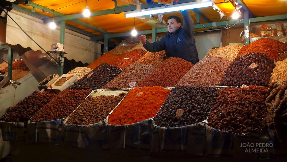 Man selling dried fruits at Jema El Fnaa square, Marrakesh