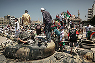 Misrata residents survey an exhibition of captured tanks and various weapons from Gadhafi's army in downtown Misrata. 10 June 2011.