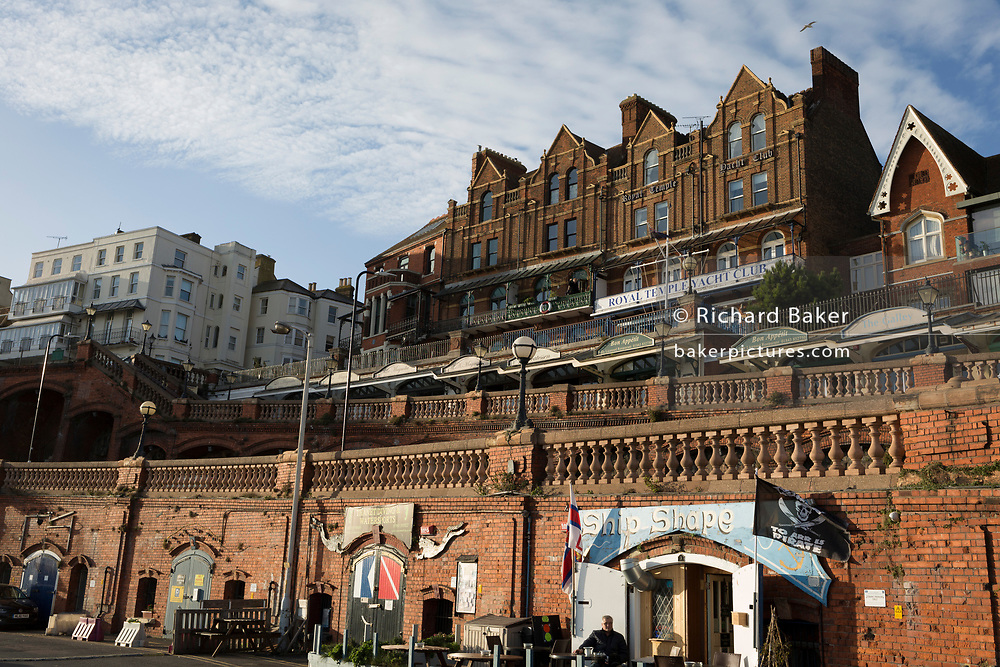 Local businesses on Ramsgate's Military Road and Royal Temple Yacht Club on Royal Parade, on 8th January 2019, in Ramsgate, Kent, England. The Port of Ramsgate has been identified as a 'Brexit Port' by the government of Prime Minister Theresa May, currently negotiating the UK's exit from the EU. Britain's Department of Transport has awarded to an unproven shipping company, Seaborne Freight, to provide run roll-on roll-off ferry services to the road haulage industry between Ostend and the Kent port - in the event of more likely No Deal Brexit. In the EU referendum of 2016, people in Kent voted strongly in favour of leaving the European Union with 59% voting to leave and 41% to remain.