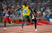 epa01458564 Jamaica's Usain Bolt wins the men's 200m final at the Beijing 2008 Olympic Games, 20 August 2008. Bolt won in new World Record time of 19.30 seconds.  EPA/Nic Bothma