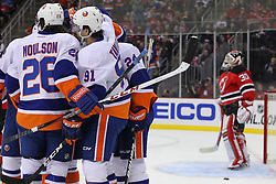 Jan 31, 2013; Newark, NJ, USA; New York Islanders center John Tavares (91) celebrates his goal against New Jersey Devils goalie Martin Brodeur (30) during the first period at the Prudential Center.