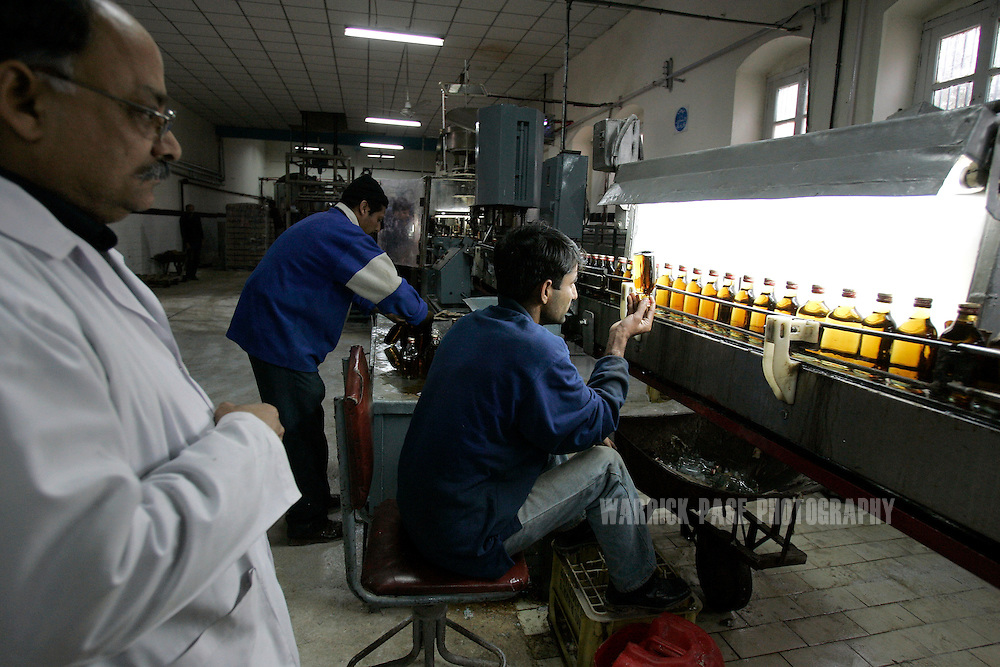 Quality control inspectors check bottles of whiskey on the production line at the Murree Brewery, Wednesday, February 14, in Rawalpindi, Pakistan. The brewery boasts the first 20 year-old malt whiskey in the Muslim world, due for release in mid-2007. Established more than a century ago under British Raj, Murree Brewery also is Pakistan's oldest company and one of two breweries in a country under prohibition. Muslims have been banned from drinking alcohol since it was outlawed in 1977, but Christians and Hindus may still buy alcohol. The brewery hopes to export the exclusive whiskey to Europe and the Middle East. (Photo by Warrick Page)