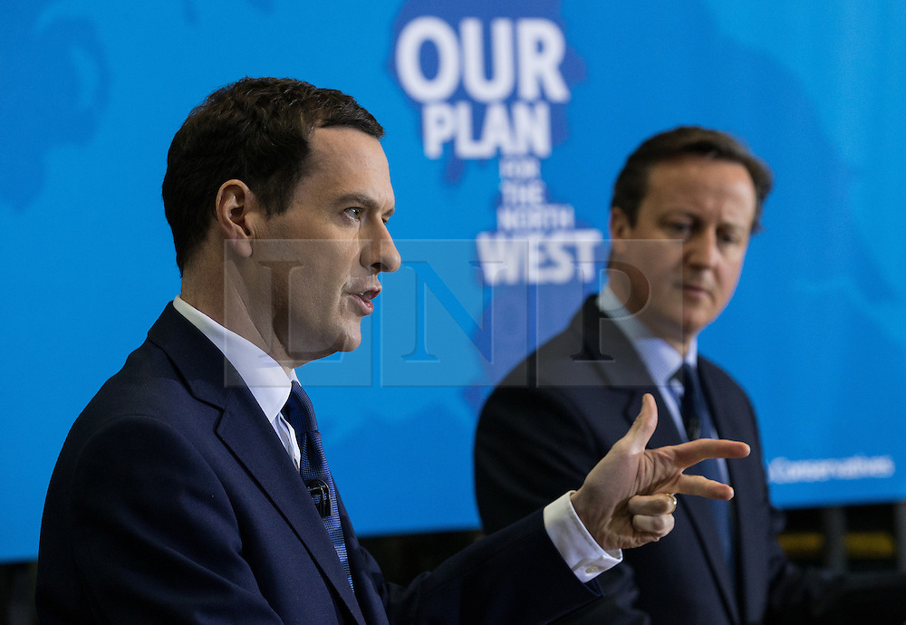 © Licensed to London News Pictures . 20/04/2015 . Crewe , UK . George Osborne and David Cameron campaigning in an Arriva train shed in Crewe , Cheshire as part of the Conservative Party's election run . Photo credit : Joel Goodman/LNP
