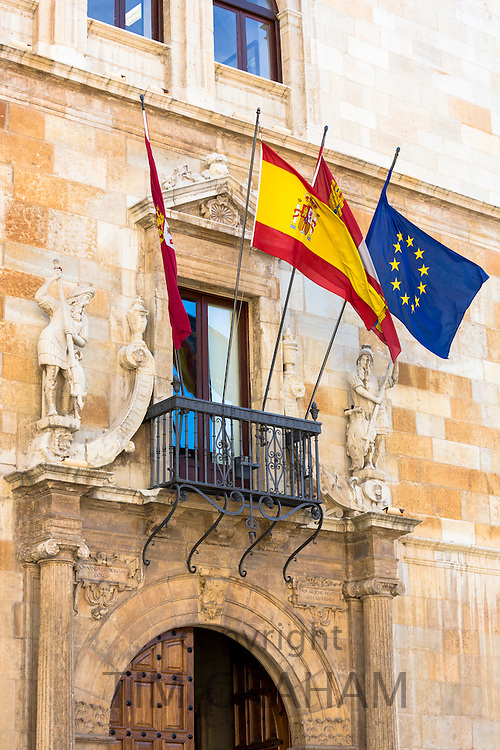 European Union and Spanish flag at 16th Century Palacio de los Guzmanes by Rodrigo Gil de Hontanon in Leon, Castilla y Leon, Spain