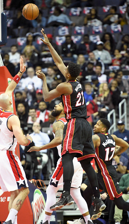 WASHINGTON, DC - APRIL 8: Miami Heat center Hassan Whiteside (21) scores in the first half against Washington Wizards center Marcin Gortat (13) on April 8, 2017, at the Verizon Center in Washington, D.C.  The Miami Heat defeated the Washington Wizards 106-103.  (Photo by Icon Sportswire)
