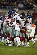 Teammates mob New York Giants middle linebacker B.J. Goodson (93) after he intercepts a fourth quarter pass at the Giants 46 yard line during the NFL week 10 regular season football game against the San Francisco 49ers on Monday, Nov. 12, 2018 in Santa Clara, Calif. The Giants won the game 27-23. (©Paul Anthony Spinelli)