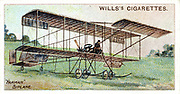 Henri Farman (1874-1958), French aviator and aircraft constructor. Farman biplane c1909. From set of cards on aviation published 1910. Chromolithograph.
