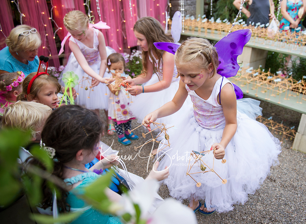 """Glimmer"", ""Shimmer"" and ""Shine"" hand out gazebos to catch magic to visitors at Cackleberries Garden Center's Fairy Night Wednesday evening.  (Karen Bobotas/for the Laconia Daily Sun)"