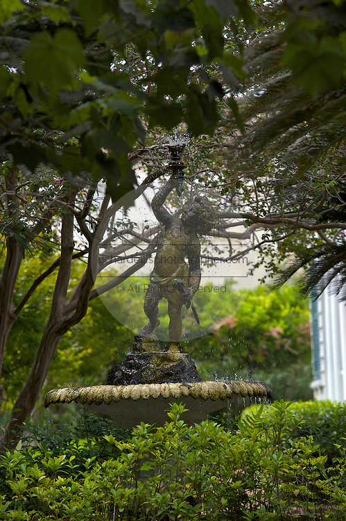 A fountain in the gardens of the historic Nathaniel Russell House in Charleston, SC. Charleston founded in 1670 is considered America's most beautifully preserved architectural and historic city.