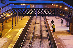 © Licensed to London News Pictures.  05/12/2012. AYLESBURY, UK. Commuters wait for a delayed train at Stoke Mandeville station near Aylesbury, Buckinghamshire. The first widespread snowfall of winter is causing travel disruption. Photo credit :  Cliff Hide/LNP