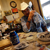 ARCHER, FL -- August 23, 2009 -- Larry Ford smokes a cigarette in the living room of his home in Archer, Fla., on Sunday, August 23, 2009.  The self-described cowboy lives on seven acres in rural Florida with a horse, 4 dogs, and a handful of cats on his property after his wife died three years ago.  He took out a reverse mortgage on his home, but in July, the owner of the Orlando, Fla., title company that handled Mr. Fordâ??s loan admitted to stealing more than $1 million from several reverse mortgages, including Mr. Fordâ??s. Bank of America Corp., which says the title agent never sent it the money required to pay off Mr. Fordâ??s mortgage, is now threatening to foreclose on his ranch..(CREDIT:  Chip Litherland for the Wall Street Journal)..REVERSE