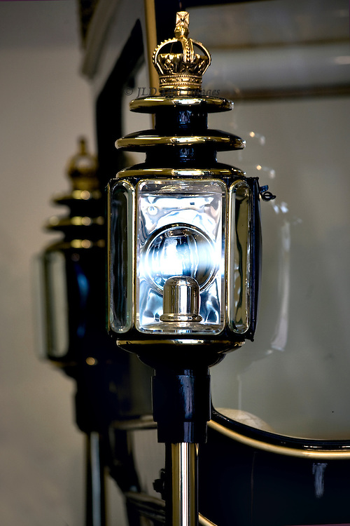 """Carriage lamp on the """"glass coach"""" in the Royal Mews at Buckingham Palace.  Detail of the lamp, showing a bit of the coach."""