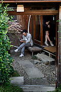 Tokyo, May 18th 2013 - Modern couple in traditional Japanese garden