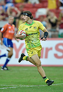 Australia's Liam McNamara makes a break to score during the HSBC World Rugby Sevens Series - Singapore , Bronze match Australia-V-England at The National Stadium, Singapore on Sunday, April 16, 2017. (Steve Flynn/Image of Sport)