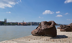 BUDAPEST, HUNGARY - Tuesday, June 11, 2019:  The Shoes on the Danube Bank is a memorial in Budapest, Hungary. Conceived by film director Can Togay, he created it on the east bank of the Danube River with sculptor Gyula Pauer to honour the Jews who were killed by fascist Arrow Cross militiamen in Budapest during World War II. They were ordered to take off their shoes, and were shot at the edge of the water so that their bodies fell into the river and were carried away. It represents their shoes left behind on the bank. (Pic by David Rawcliffe/Propaganda)