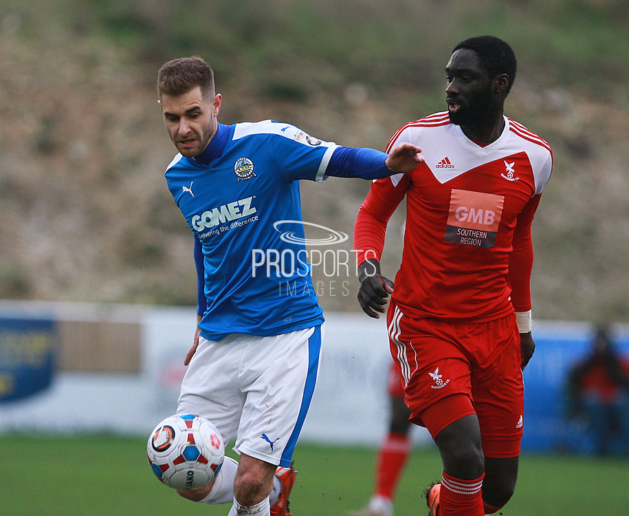 Dover midfielder Nicky Deverdics shields the ball from Arnaud Mendy during the FA Trophy match between Whitehawk FC and Dover Athletic at the Enclosed Ground, Whitehawk, United Kingdom on 12 December 2015. Photo by Bennett Dean.