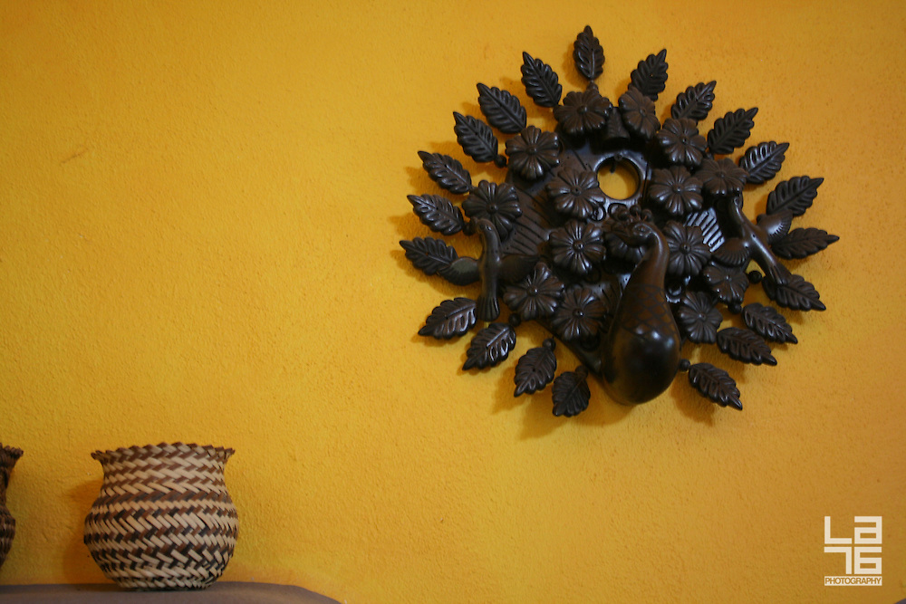 Detail of a decoration on a yellow wall.<br />