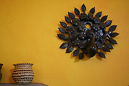Detail of a decoration on a yellow wall.<br /> Interior decoration is done by feng shui rules. The home is a beach front home in Los Barriles, Baja California Sur. <br /> Photo is part of set of photographs of a beach front home in Los Barriles, Baja California Sur, Mexico.