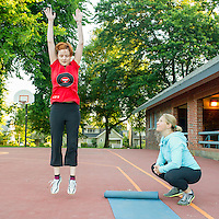 Personal trainer Angelique Tourbier of Studio Blue (right) directs Anna Rigby with her morning workout in Wallace Park (NW 25th Ave. and Raleigh St.) 6:22am
