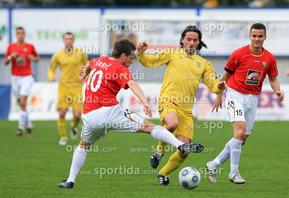 Denis Grbic of Rudar vs Danijel Brezic of Domzale at 26th Round of Slovenian First League football match between NK Domzale and NK Rudar Velenje in Sports park Domzale, on April 4, 2009, in Domzale, Slovenia. (Photo by Vid Ponikvar / Sportida)