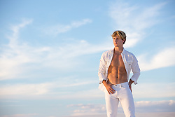 sexy man with an open shirt at sunset