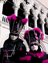 Masked people in Carnival or Carnevale in Venice Italy