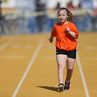 London Hamblin makes her way down the track in the 100m dash at Wednesday's Special Olympic's at Tupelo High School.