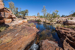 Water flows in a waterhole on a tributary of the Isdell River in the King Leopold Range on Mt Hart.