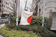 person folding the Japanese flag Tokyo
