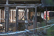 © Licensed to London News Pictures. 15/01/2015. Crowmarsh, UK. A burnt out vehicle in the main reception of the building.  Fire has engulfed council offices in Oxfordshire and two other buildings following a spate of suspected arson attacks overnight. A 47-year-old man has been arrested following the blaze at the South Oxfordshire District Council building in Crowmarsh Gifford.. Photo credit : Stephen Simpson/LNP