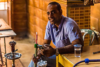 Man smoking sheesha (waterpipe), Al-Rasheed Court Cafe (a.k.a. Eco-tourism Cafe), Downtown Amman, Jordan.
