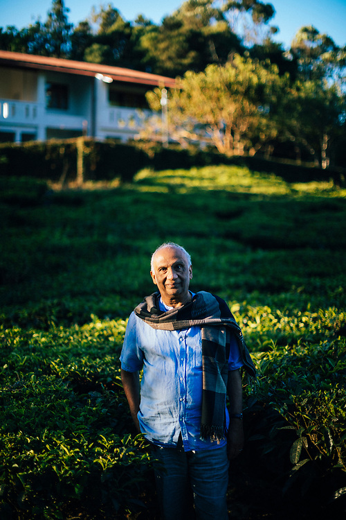 Munnar, India -- February 16, 2018: A portrait of Dr. Simon, owner of the Windermere Estate set amongst tea fields and cardamom plantations in the hills of Kerala.