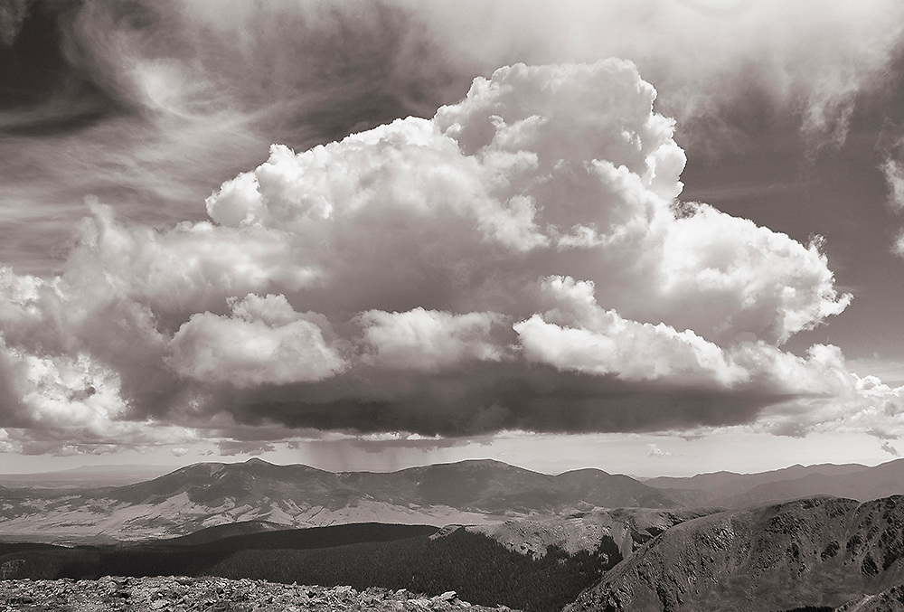 A fine art black and white photograph of a storm cloud over Wheeler Peak, New Mexico. USA.<br />