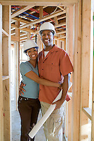 Young couple on building site