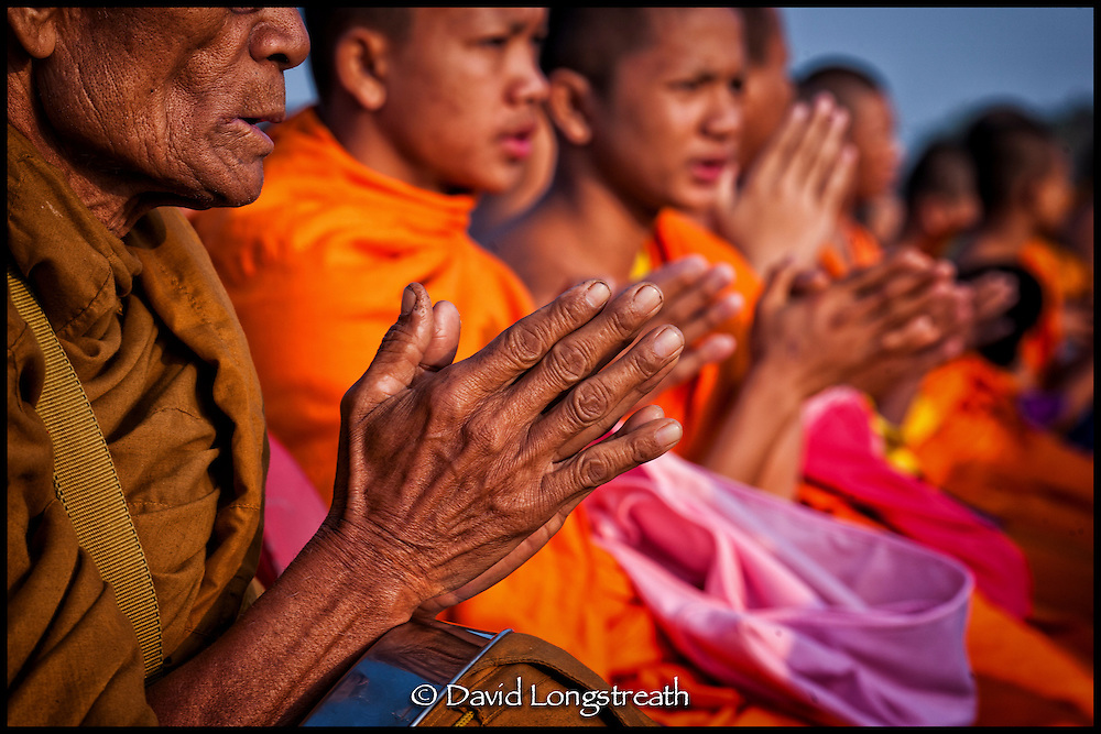 Buddhist monks gather for offerings and prayers in Thailand.