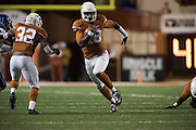 AUSTIN, TX - NOVEMBER 7:  Tyrone Swoopes #18 of the Texas Longhorns scrambles for a 44 yard touchdown against the Kansas Jayhawks during the 4th quarter on November 7, 2015 at Darrell K Royal-Texas Memorial Stadium in Austin, Texas.  (Photo by Cooper Neill/Getty Images) *** Local Caption *** Tyrone Swoopes